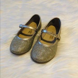 Shiny gold dress shoes